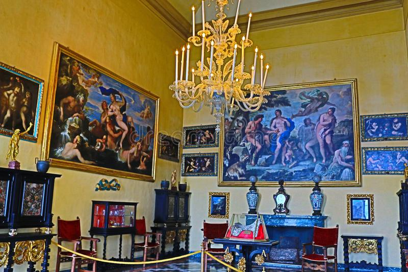 Opulent Baroque palace interior Isola Bella Italy. A rooms filled with paintings of famous artists, intricate mosaic tiled floors and opulent furniture in the stock photos