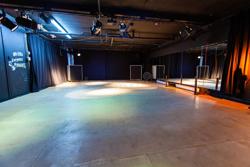 Rooms for rent in community arts center. A wide angled view of a large dance hall inside a local youth club. Spotlights are seen illuminating a deserted floor stock photos