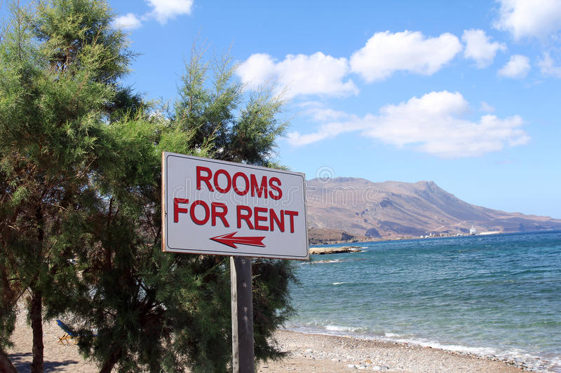 Rooms for rent sign on beautiful beach stock photo
