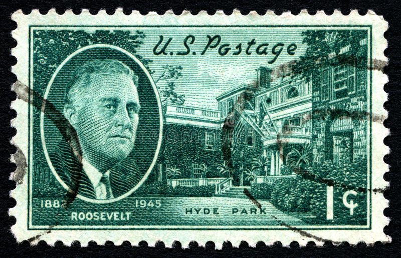 Roosevelt US Postage Stamp. UNITED STATES OF AMERICA - CIRCA 1945: A used posted stamp from the USA depicting an illustration of President FD Roosevelt and his royalty free stock images