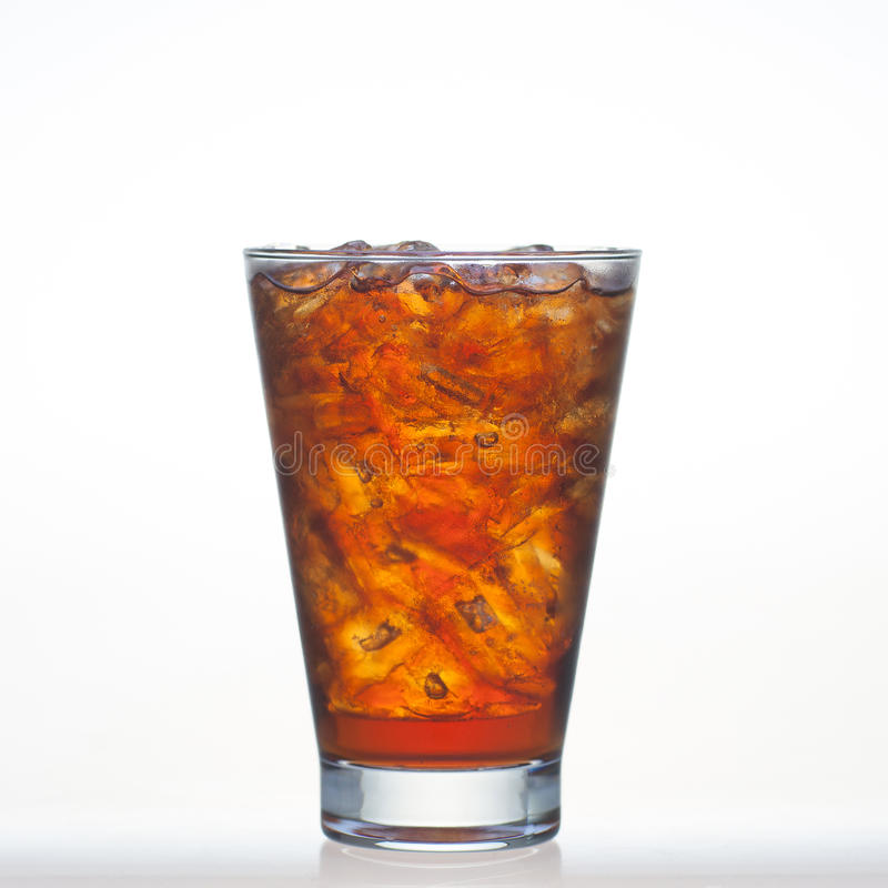 Root beer flavour soft drinks with soda water and ice in glass is. Root beer flavour soft drinks with soda water and ice in glass on white royalty free stock photos