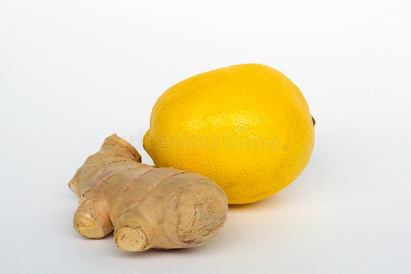 Root of ginger and fresh lemon isolated on white background stock images