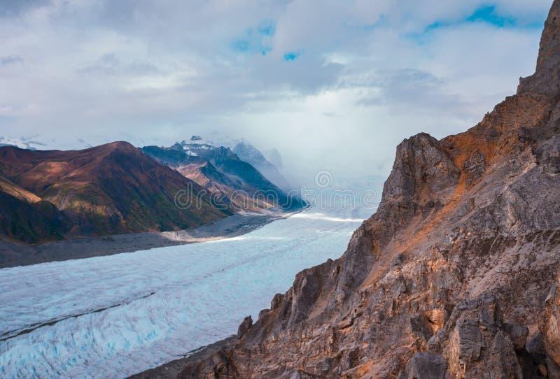 Root Glacier rolls past Kennicott in McCarthy Alaska royalty free stock photography