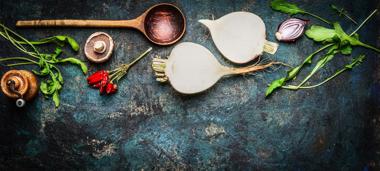 Root vegetables with wooden spoon and fresh ingredients for healthily cooking on rustic background, top view, banner. royalty free stock photography