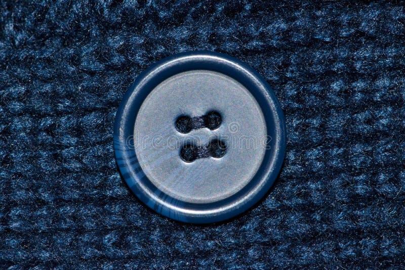 Ropa azul de las lanas con el botón azul foto de archivo libre de regalías