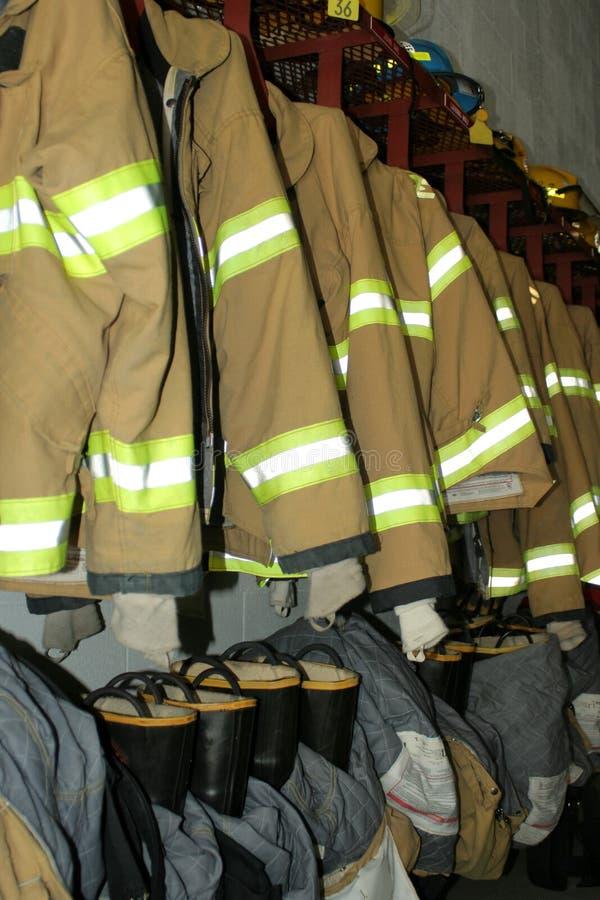 Ropa del bombero imagenes de archivo