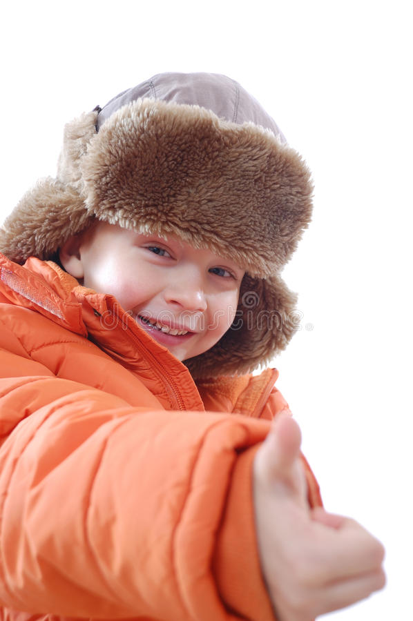 Ropa del invierno del niño que desgasta feliz imagenes de archivo