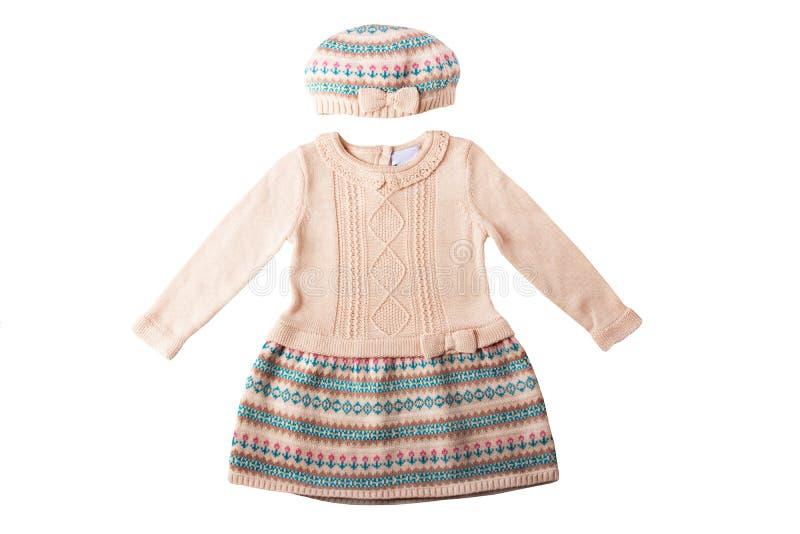 Ropa para los niños Un vestido y un sombrero brillantes rosados hermosos de la muchacha fotos de archivo
