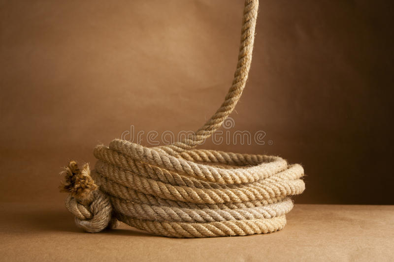 Hemp rope coiled and hanging royalty free stock photos