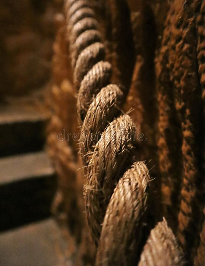 Rope banister going up the stairs stock images