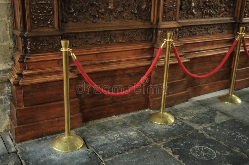 Rope barriers on VIP entrance. Copper Red rope barriers on VIP entrance royalty free stock images