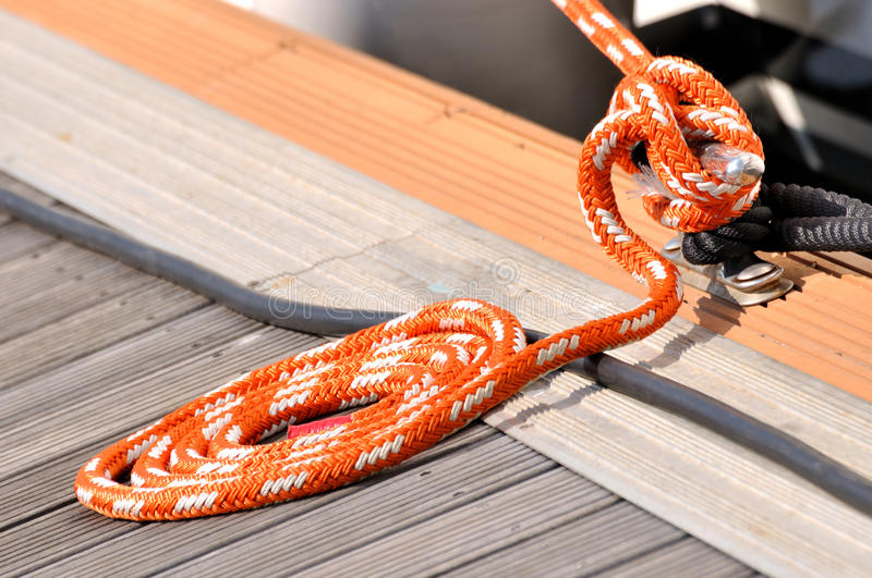 Download Rope Of Boat Twist Into Circle On Dock Stock Photo - Image of rail, travel: 21717566