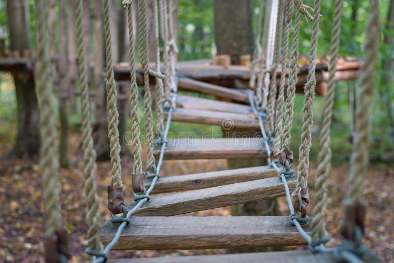Rope bridge at adventure climbing park stock photo