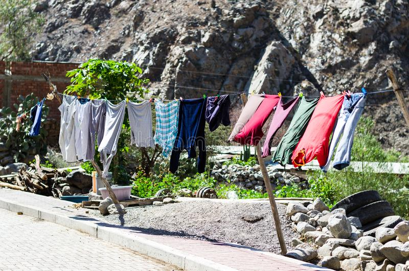 Rope with clean clothes outdoors on laundry day royalty free stock image