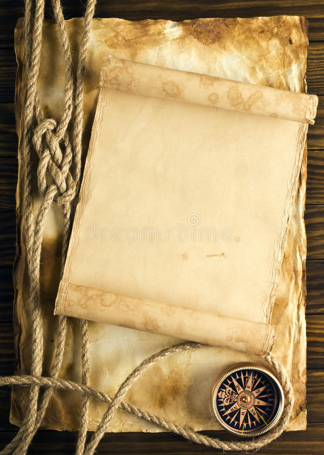 Rope and compass on the old paper stock photography