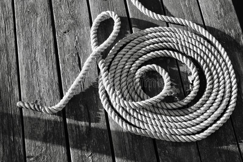 Rope on dark boards stock photography