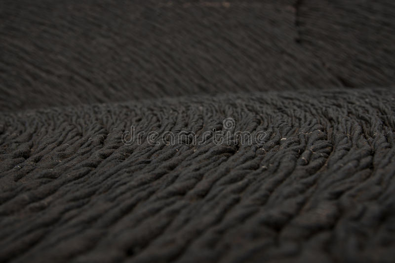 Rope detail from pahoehoe lava, Galapagos. A detail of rope lava (pahoehoe) in a lava field on Isle Santiago of the Galapagos royalty free stock photos