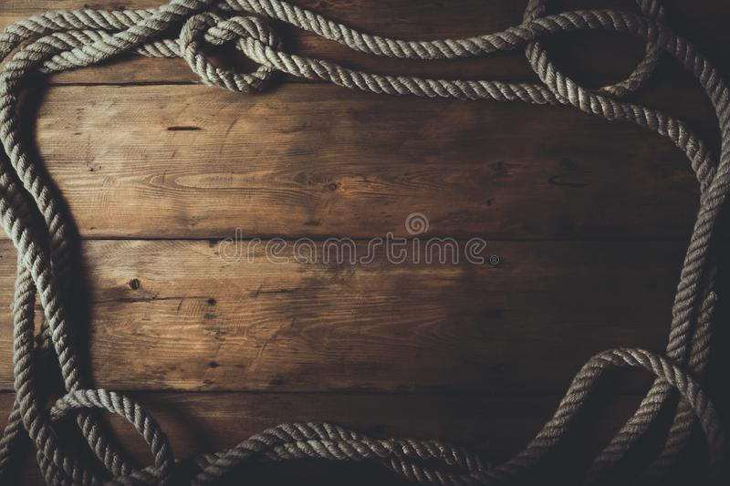 rope frame on old brown wooden background royalty free stock photography