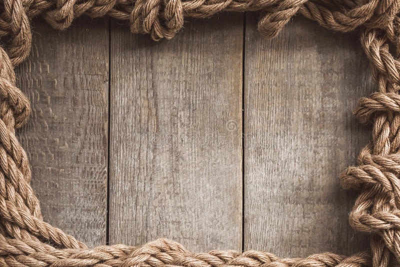 Rope frame on wooden background royalty free stock image