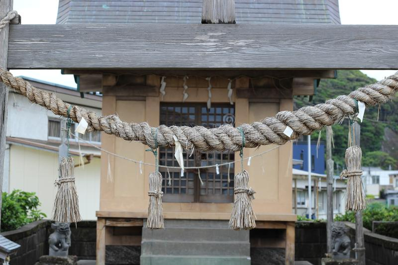 Rope in front of a Japanese Shinto shrine royalty free stock photo