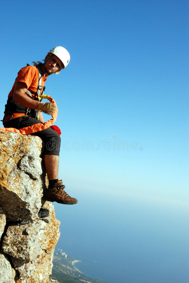 Rope jumping. Jump off a cliff with a rope, mountain, sea, nature stock image