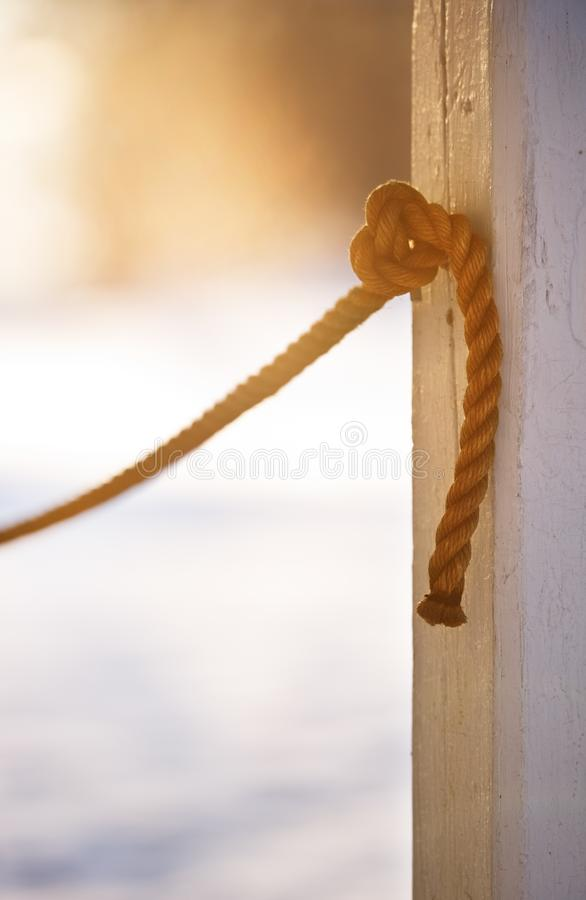 Rope knotted tight. In to the pole. Focus on knot stock images