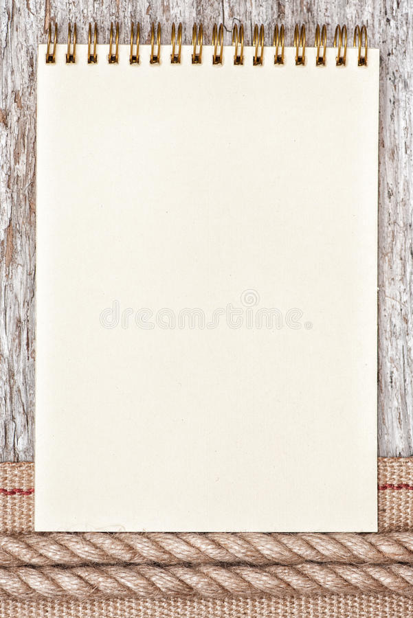 Rope, paper notebook and hardware ribbon on the old wood royalty free stock photos