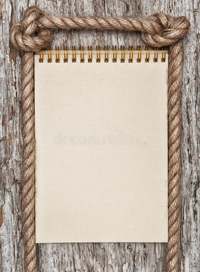 Rope Paper Spiral Notebook And Wood Background Stock