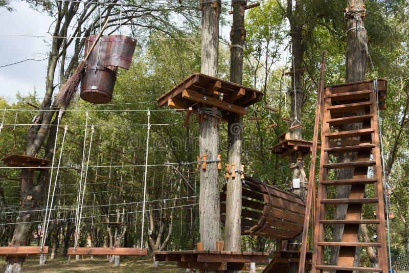 Rope park for children. Fun children`s attraction rope park. Extreme rope attraction. stock photos