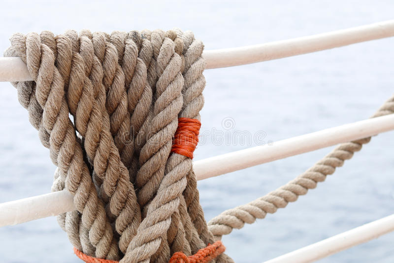 Rope on ship`s rail stock image