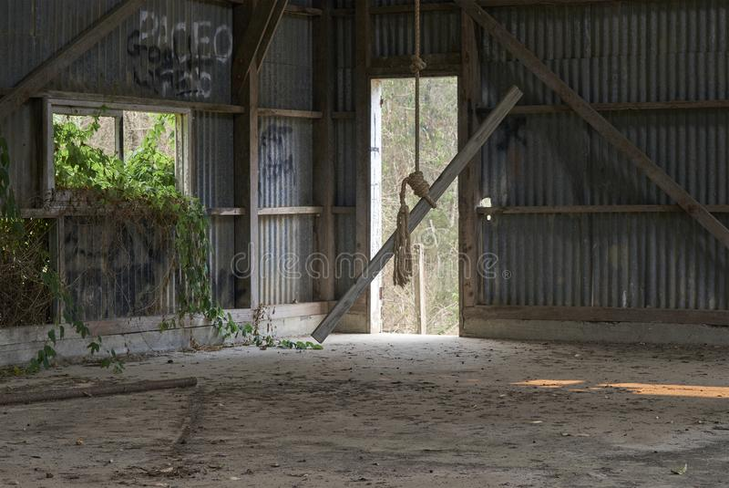 Rope-swing in Abandoned Industrial Building royalty free stock photography