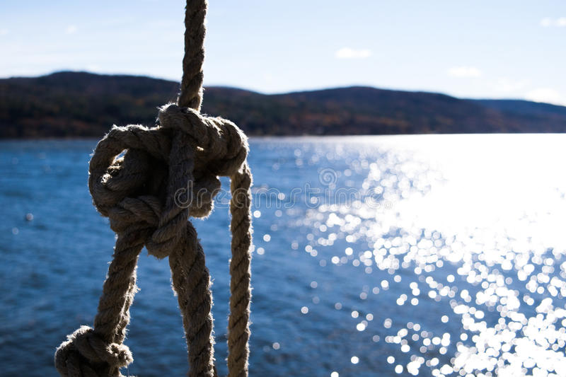 Rope swing over the water royalty free stock photos