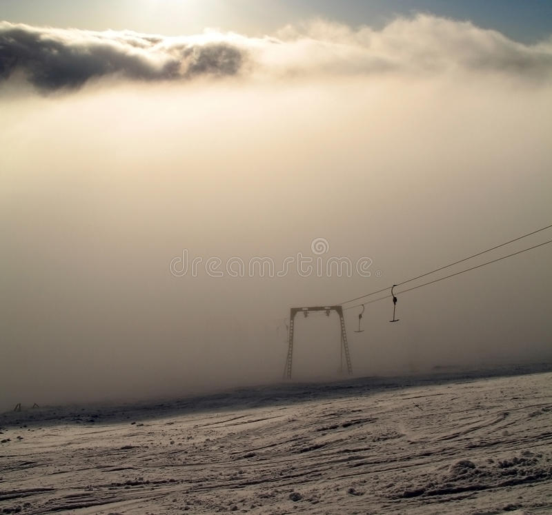 Rope tow in fog royalty free stock photo