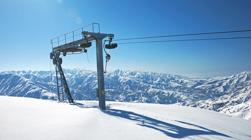 The rope tow lift. In ski resort in mountains royalty free stock image