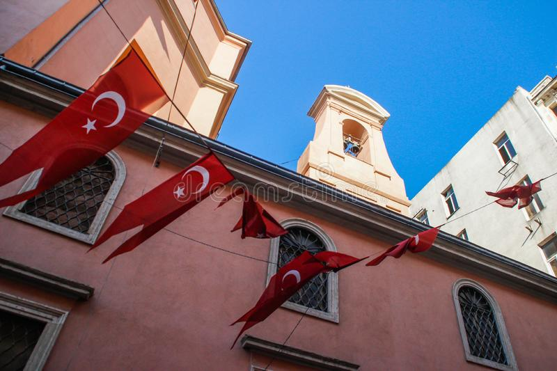 Rope with Turkish flags on the background. Of the church stock photography