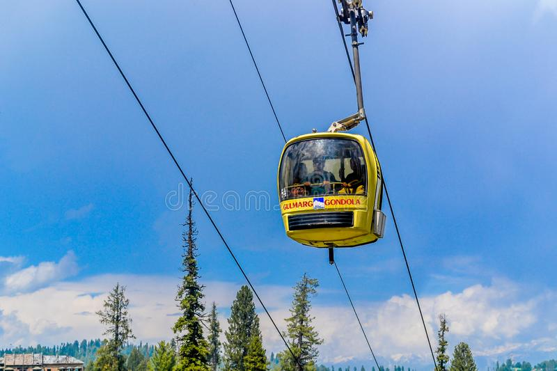 Rope ways or Gandola Cable car in Gulmarg Ski Area of Jammu and Kashmir called `Paradise on Earth` in India. World`s highest stock photography