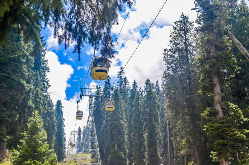 Rope ways or Gandola Cable car in Gulmarg Ski Area of Jammu and Kashmir called `Paradise on Earth` in India. World`s highest stock photos