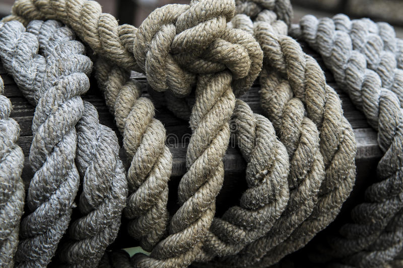 Rope wooden boat. Ropes from an old sailing boat, close-up stock images