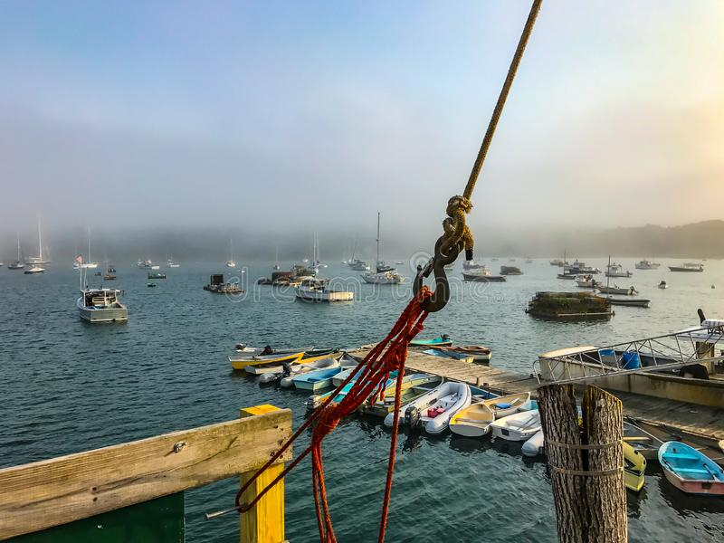 Ropes, Boats and Fog on a Maine Harbor stock photography