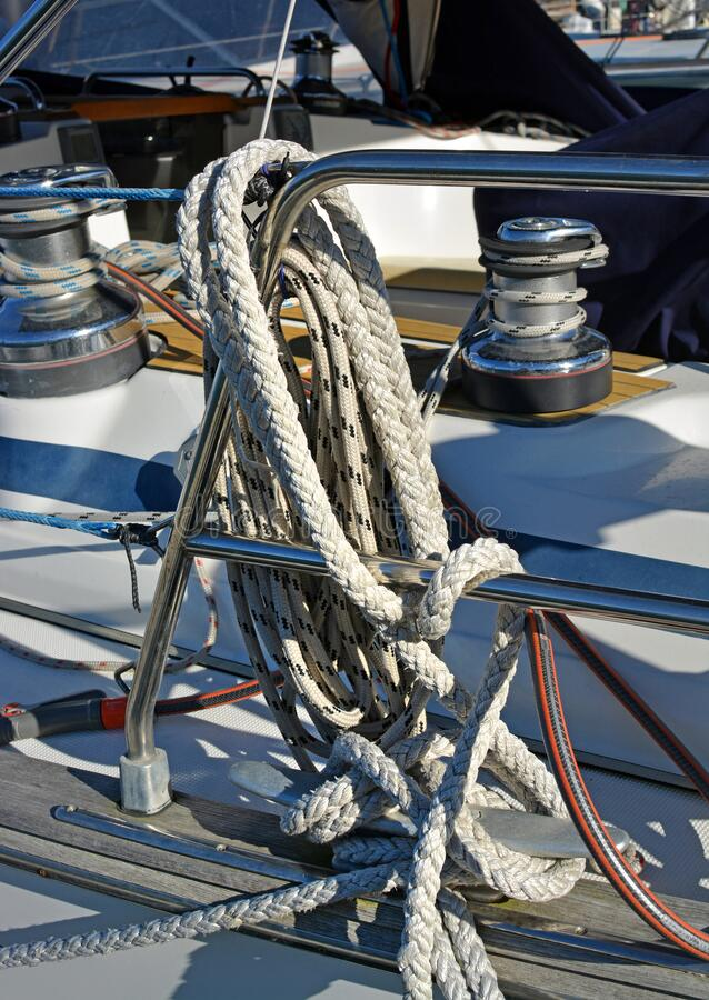 Ropes & Boats - Marine ropes, railing and winches on Yacht stock image