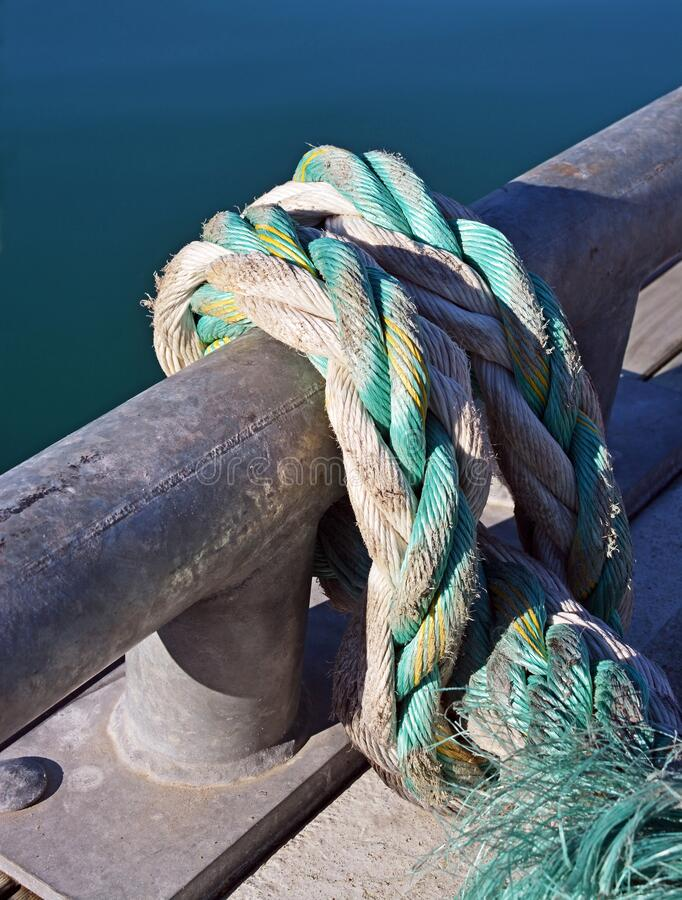 Ropes & Boats - Massive Braided Nautical Plastic Ropes Closeup Detail royalty free stock photo