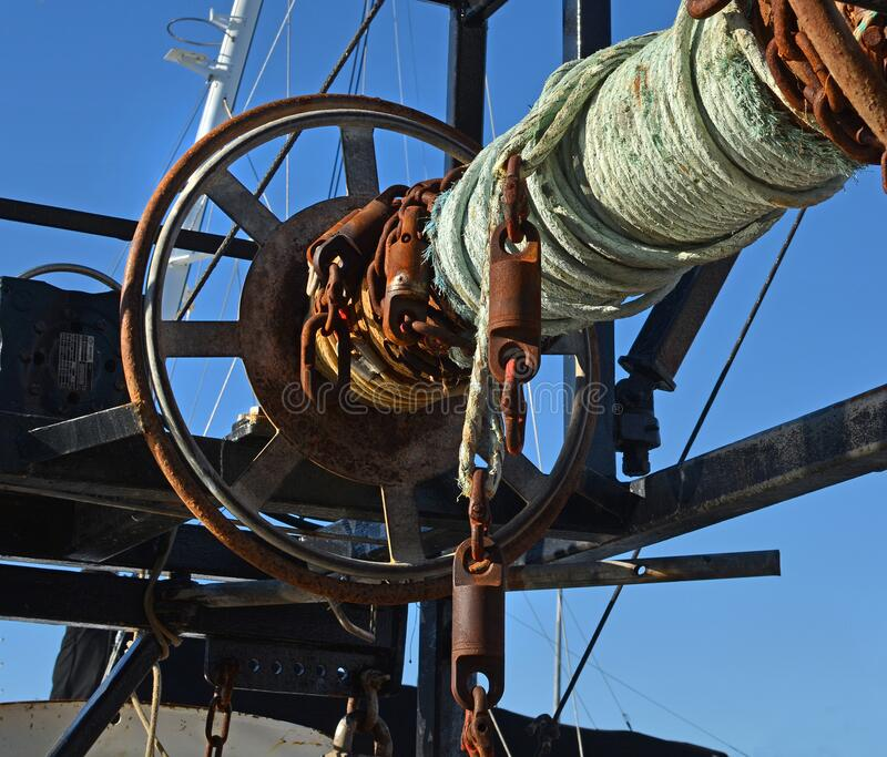 Ropes & Boats - Rusty old winch detail on fishing trawler stock photo