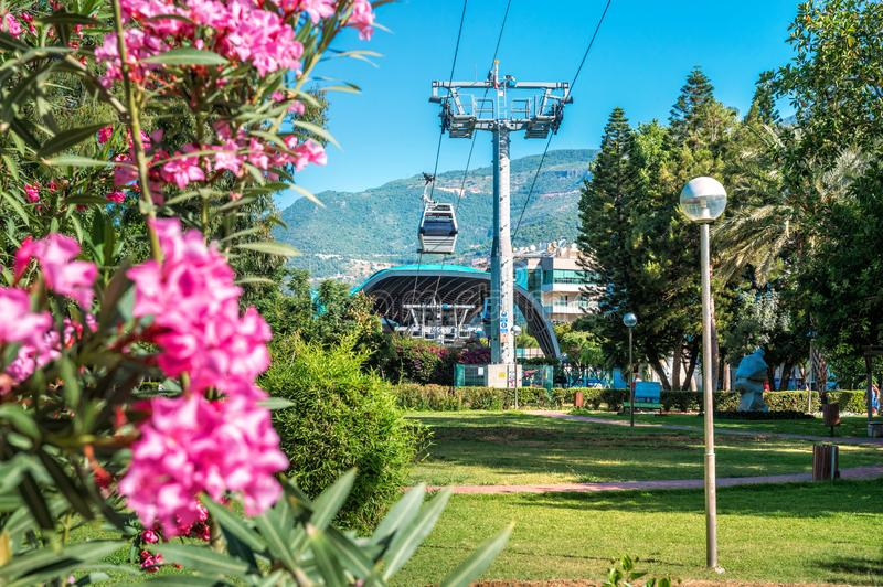 Ropeway in Alanya. Turkey. Ropeway in Alanya and the pink flowers of oleander royalty free stock photos