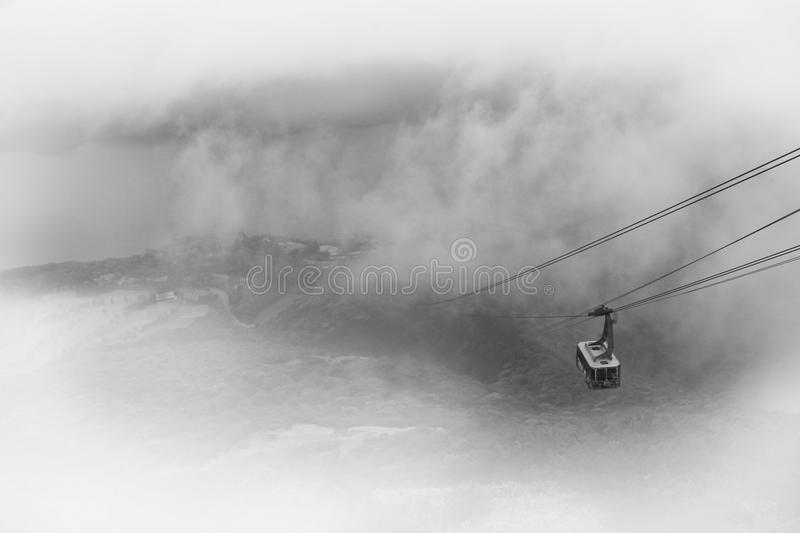 Ropeway into the fog stock images