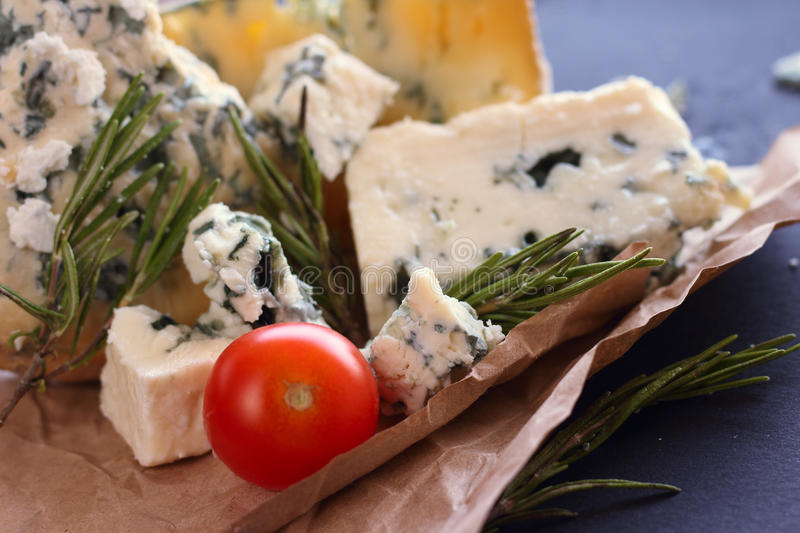 Roquefort cheese composition. On dark background royalty free stock photography
