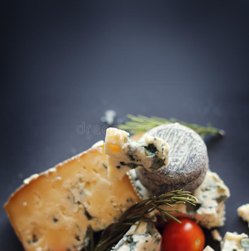 Roquefort cheese composition. On dark background stock photography