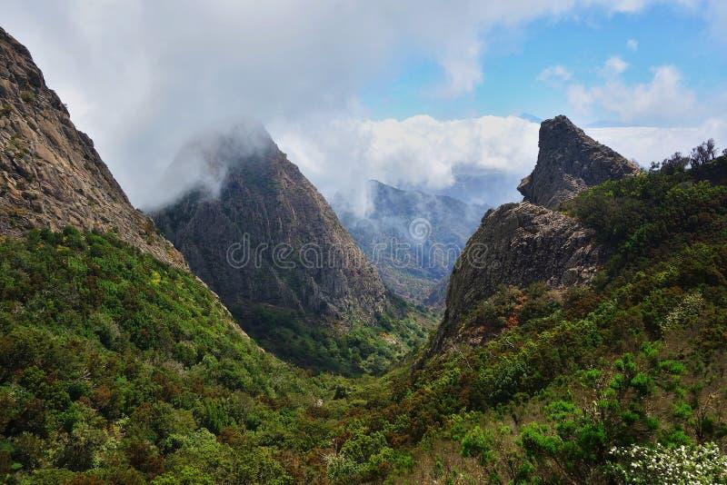 Roques in La Gomera. Rocks under the clouds in La Gomera island stock photo