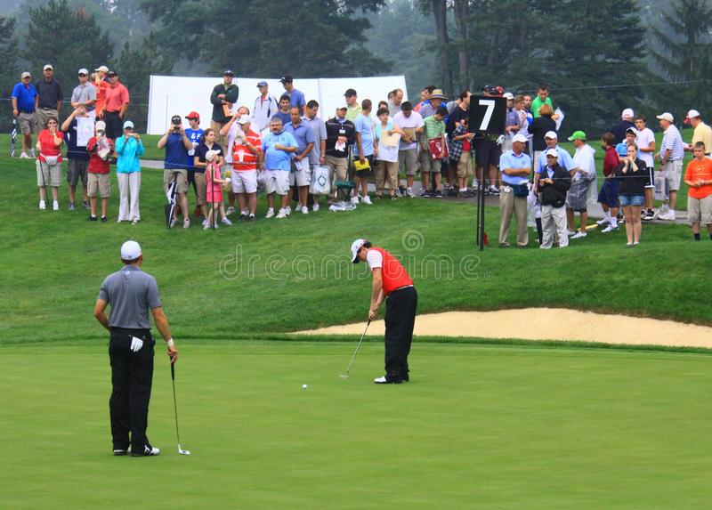 Rory McElroy. Puts a shot on the green as the crowd watches the action stock images