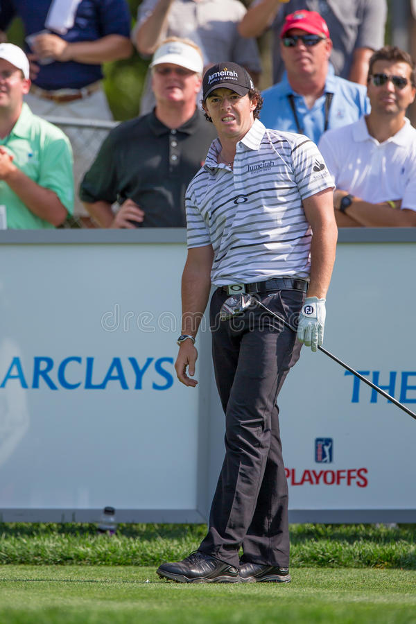 Rory McIlroy at the 2012 Barclays. FARMINGDALE, NY - AUGUST 21: Rory McIlroy reacts to a shot as he plays in the Barclays on Bethpage Black on August 21, 2012 in stock photos