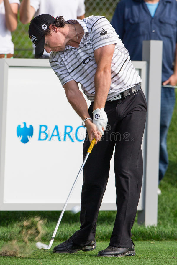 Rory McIlroy at the 2012 Barclays. FARMINGDALE, NY - AUGUST 21: Rory McIlroy hits a drive as he plays in the Barclays on Bethpage Black on August 21, 2012 in royalty free stock images